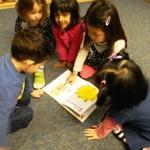 Aidan, Celine, Stella, Erin read yoga book